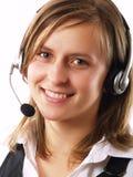 Femme utilisant un écouteur Photos stock