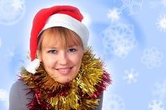Femme utilisant un chapeau de Santa Photo libre de droits