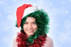 Femme utilisant un chapeau de Santa Photos libres de droits