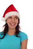 Femme utilisant un chapeau de Santa Photographie stock