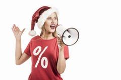 Femme utilisant un chapeau de Santa Claus Photo libre de droits