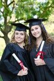Femmes assez jeunes à la graduation Image libre de droits