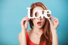 Femmes avec amour de mot Photographie stock