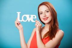 Femmes avec amour de mot Image stock