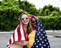 Femmes avec le drapeau américain de nation Image libre de droits