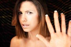 Femmes avec le signe d'arrêt de main Image stock