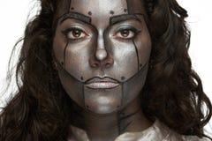 Femmes avec le visage argenté photos libres de droits