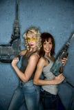 Femmes avec les perforateurs lourds Photographie stock libre de droits
