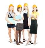 Femmes d'affaires dans le casque antichoc avec des documents Photos libres de droits
