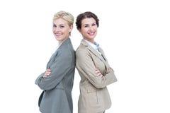 Femmes d'affaires sérieuses reculant en fonction arrières images stock