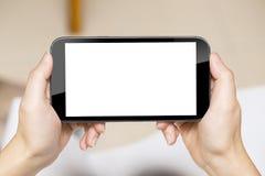 Femmes d'affaires tenant le téléphone intelligent image stock