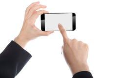 Femmes d'affaires tenant le téléphone intelligent photographie stock