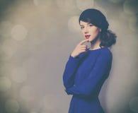 Femmes dans la robe bleue Photos libres de droits