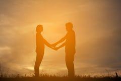 Femmes de silhouette et homme des amants Photo stock