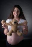 Femmes enceintes et crabot de substance Photos stock