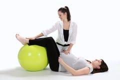 Femmes enceintes et forme physique d'infirmière Photographie stock