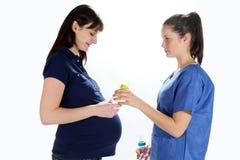 Femmes enceintes et infirmière Images libres de droits