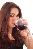 Femmes goûtant une glace de vin rouge Photographie stock