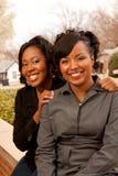 Femmes heureuses d'Afro-américain riant et souriant Images stock