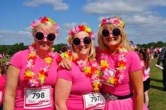 Femmes à la course pour l'événement de vie Photos stock