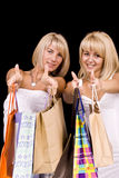 Femmes portant des sacs à provisions Images libres de droits
