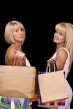 Femmes portant des sacs à provisions Photos stock
