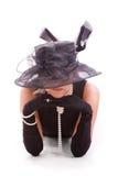 Femmes regardant du chapeau images stock