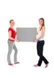 Femmes retenant l'affiche Images stock
