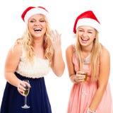 Femmes riantes célébrant Noël Photos stock