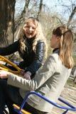 Femmes sur le carrousel Images libres de droits