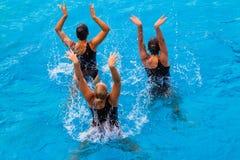 Femmes synchronisées trois mains   Images stock