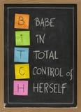 Femmina - acronimo divertente sulla lavagna Fotografie Stock Libere da Diritti