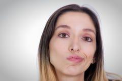 Femmina che fa un fronte Fotografie Stock