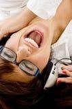 Femmina che gode della musica con le cuffie Fotografie Stock