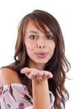Femmina che salta un bacio voi Immagini Stock