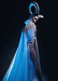 Femmina con body art della capra Immagini Stock