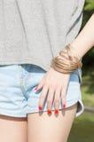 Femmina con i braccialetti Immagini Stock Libere da Diritti