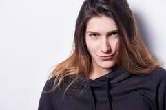 Femmina con il sorriso scettico Fotografia Stock Libera da Diritti