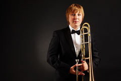 Femmina con il trombone Fotografia Stock Libera da Diritti