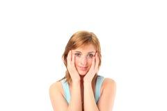 Femmina con le sue mani sul suo fronte fotografia stock