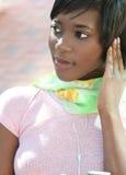 Femmina del African-American con il giocatore Mp-3 Immagini Stock