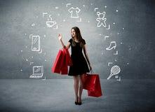 Femmina di compera con le borse e le icone tirate Fotografie Stock Libere da Diritti