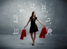 Femmina di compera con le borse e le icone tirate Immagine Stock
