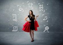 Femmina di compera con le borse e le icone tirate Fotografie Stock