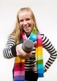 Femmina graziosa con il microfono isolato Fotografia Stock