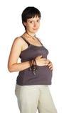 Femmina incinta con il percorso di residuo della potatura meccanica Fotografie Stock