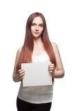 Femmina nel segno casuale della holding dell'attrezzatura Immagini Stock Libere da Diritti