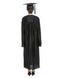 Femmina in protezione ed abito di graduazione che si levano in piedi indietro Fotografia Stock Libera da Diritti