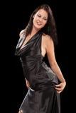 Femmina seducente di dancing sui precedenti neri fotografia stock libera da diritti