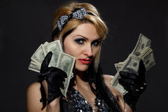 Femmina con il ventilatore dei dollari Fotografie Stock Libere da Diritti
